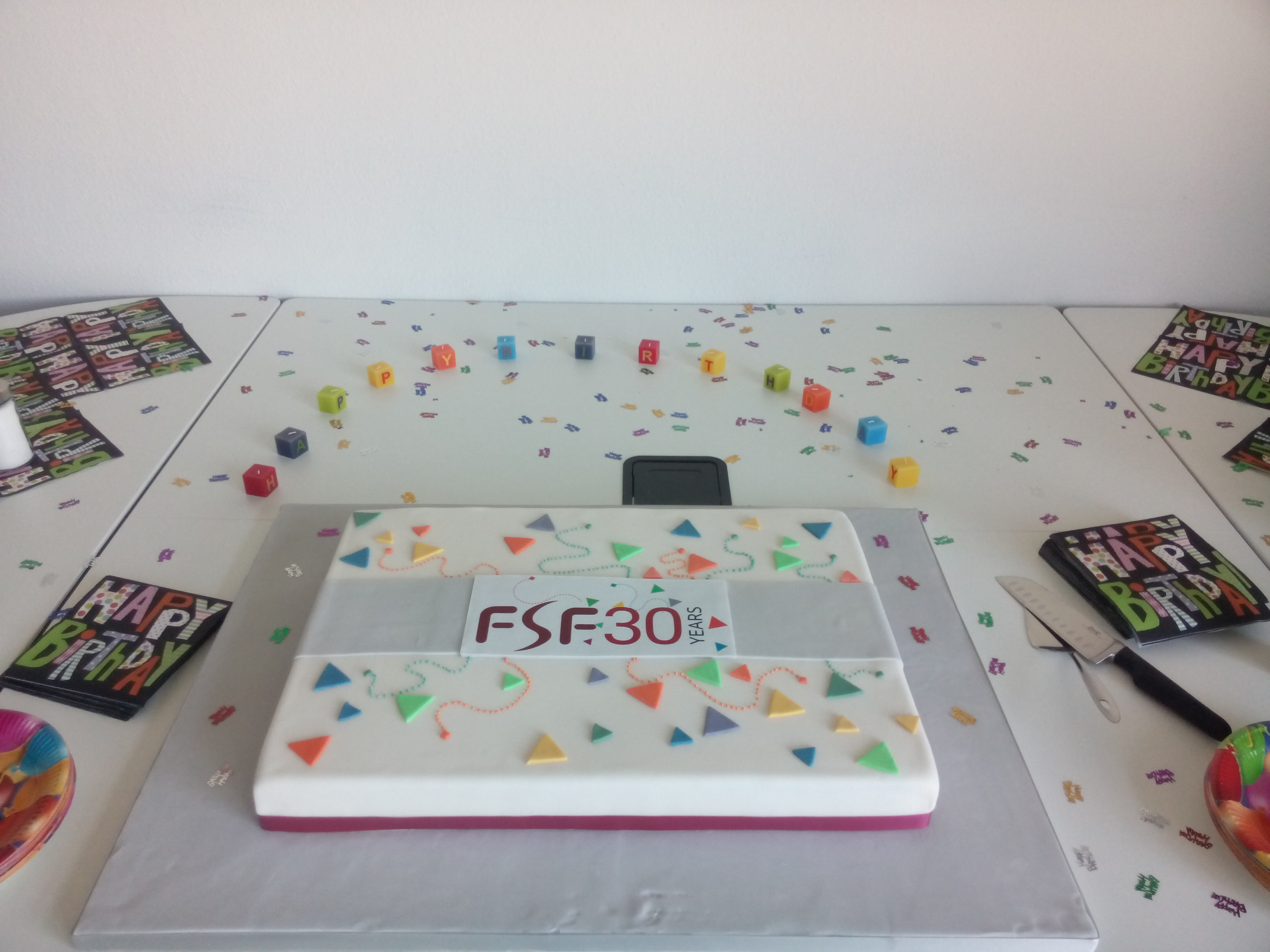 A cake with the FSF30 birthday logo on it